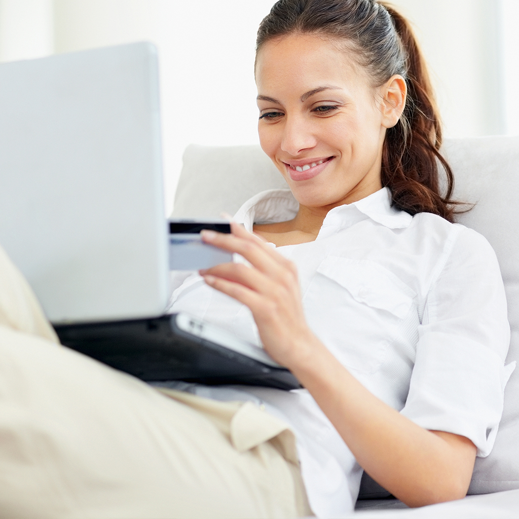 Woman with laptop happy with Visa Checkout process